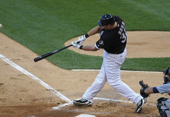 CHICAGO, IL - JULY 26: Adam Dunn #32 of the Chicago White Sox hits a two-run home run in the 1st inning against the Detroit Tigers at U.S. Cellular Field on July 26, 2011 in Chicago, Illinois. (Photo by Jonathan Daniel/Getty Images)