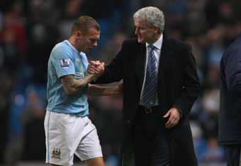 Bellamy with long time believer Mark Hughes While at Manchester City