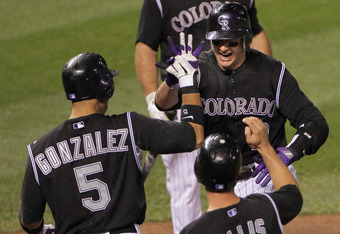 DENVER, CO - SEPTEMBER 06:  Troy Tulowitzki #2 of the Colorado Rockies celebrates his three run homerun off of David Hernandez #30 of the Arizona Diamondbacks with teamates Carlos Gonzalez #5, Mark Ellis #14 and Ty Wigginton #21 of the Colorado Rockies in