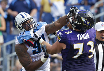 NASHVILLE, TN - SEPTEMBER 18:  Jason Jones #91 of the Tennessee Titans and Marshal Yanda #73 of the Baltimore Ravens grab each other while blocking at the LP Field on September 18, 2011 in Nashville, Tennessee.  The Titans defeated the Ravens 26 to 13.