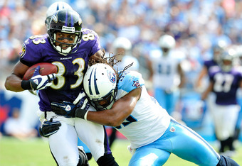 NASHVILLE, TN - SEPTEMBER 18:  Michael Griffin #33 of the Tennessee Titans tackles Lee Evans #83 of the Baltimore Ravens at LP Field on September 18, 2011 in Nashville, Tennessee. Tennessee won 26-13.  (Photo by Grant Halverson/Getty Images)