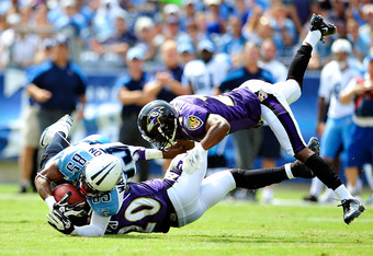NASHVILLE, TN - SEPTEMBER 18:  Ed Reed #20 and Domonique Foxworth #24 of the Baltimore Ravens tackle Nate Washington #85 of the Tennessee Titans during the first half at LP Field on September 18, 2011 in Nashville, Tennessee.  (Photo by Grant Halverson/Ge