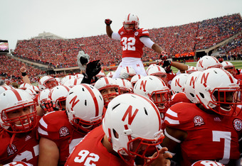 LINCOLN, NE - SEPTEMBER 17: Marcus Mendoza #32 and the Nebraska Cornhusker football team come together before playing the Washington Huskies at Memorial Stadium September 17, 2011 in Lincoln, Nebraska. Nebraska won 51-38.(Photo by Eric Francis/Getty Image