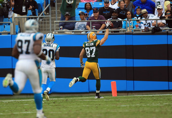 CHARLOTTE, NC - SEPTEMBER 18:   Jordy Nelson #87 of the Green Bay Packers runs for a touchdown against the Carolina Panthers during their game at Bank of America Stadium on September 18, 2011 in Charlotte, North Carolina.  (Photo by Streeter Lecka/Getty I