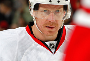 NEWARK, NJ - FEBRUARY 01:  Daniel Alfredsson #11 of the Ottawa Senators waits for a faceoff in an NHL hockey game against the New Jersey Devils at the Prudential Center on February 1, 2011 in Newark, New Jersey.  (Photo by Paul Bereswill/Getty Images)