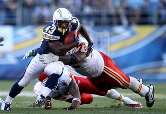 SAN DIEGO - DECEMBER 12:  Running back Darren Sproles #43 of the San Diego Chargers carries the ball against defensive end Glenn Dorsey #72 of the Kansas City Chiefs at Qualcomm Stadium on December 12, 2010 in San Diego, California.  the Chargers won 31-0