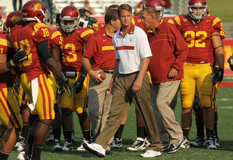 LOS ANGELES - SEPTEMBER 17:  Head coach Layne Kiffin of the USC Trojans watches warmups for the game with the Syracuse Orangemen at the Los Angeles Memorial Coliseum on September 17, 2011 in Los Angeles, California.  (Photo by Stephen Dunn/Getty Images)