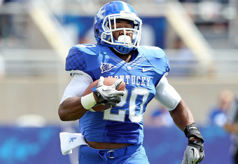 LEXINGTON, KY - SEPTEMBER 10:  Josh Clemons #20 of the Kentucky Wildcats runs with the ball for a touchdown during the game against the Central Michigan Chippewas during the game at Commonwealth Stadium on September 10, 2011 in Lexington, Kentucky.  (Phot