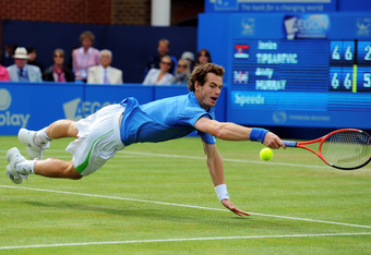 LONDON, ENGLAND - JUNE 09:  Andy Murray of Great Britain dives for the ball during his Men's Singles third round match against Janko Tipsarevic of Serbia on day four of the AEGON Championships at Queens Club on June 9, 2011 in London, England.  (Photo by
