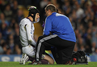 LONDON, ENGLAND - SEPTEMBER 21:  Petr Cech of Chelsea speaks to medical staff and is later substitued at half time during the Carling Cup Third Round match between Chelsea and Fulham at Stamford Bridge on September 21, 2011 in London, England.  (Photo by