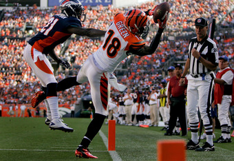 DENVER, CO - SEPTEMBER 18:  Wide receiver A.J. Green #18 of the Cincinnati Bengals makes a catch for a touchdown as Cornerback Andre' Goodman #21 of the Denver Broncos defends during the fourth quarter at Sports Authority Field at Mile High on September 1