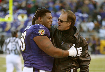 BALTIMORE - DECEMBER 7:  Head coach Brian Billick greets Orlando Brown #78 of the Baltimore Ravens as he comes off the field following a fourth quarter Jamal Lewis  touchdown against the Cincinnati Bengals as the Ravens defeated the Bengals 31-13 on Decem