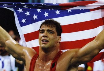 31 Jul 1996: Kurt Angle of the United States holds the American flag at the free-style wrestling competition during the Summer Olympics at the Georgia World Congress Center in Atlanta, Georgia.