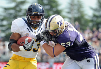 SEATTLE, WA - SEPTEMBER 24:  Covaughn DeBoskie-Johnson takes a hit from Garret Gilliland #53 of the Washington Huskies after a catch during the second quarter at Husky Stadium on September 24, 2011 in Seattle, Washington.  (Photo by Harry How/Getty Images
