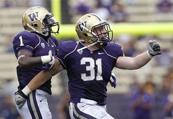 Washington safety Sean Parker (left) and linebacker Cort Dennison (right) react to a play