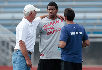 HEMPFIELD TOWNSHIP, PA - AUGUST 20:  Terrelle Pryor talks to quarterbacks coach Ken Anderson and agent Drew Rosenhaus prior to his pro day at a practice facility on August 20, 2011 in Hempfield Township, Pennsylvania.  (Photo by Jared Wickerham/Getty Imag