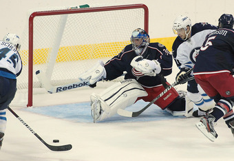 WINNIPEG, CANADA - SEPTEMBER 20: Mark Scheifele #45 of the Winnipeg Jets lines up his goal against goalie Curtis Sanford #30 of the Columbus Blue Jackets at the MTS Centre on September 20, 2011 in Winnipeg, Manitoba, Canada. (Photo by Marianne Helm/Getty