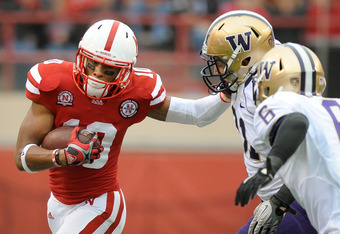 LINCOLN, NE - SEPTEMBER 17: Jamal Turner #10 of the Nebraska Cornhuskers tries to hold off Cort Dennison #31 and Desmond Trufant #6 of the Washington Huskies during their game at Memorial Stadium September 17, 2011 in Lincoln, Nebraska. Nebraska won 51-38