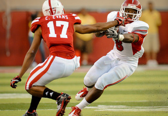 LINCOLN, NE - SEPTEMBER 10: Ciante Evans #17 of the Nebraska Cornhuskers reaches out for Robbie Rouse #8 of the Fresno State Bulldogs during their game at Memorial Stadium September 10, 2011 in Lincoln, Nebraska. Nebraska won 42-29.(Photo by Eric Francis/