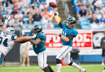 CHARLOTTE, NC - SEPTEMBER 25: Blaine Gabbert #11 of the Jacksonville Jaguars makes a screen pass against the Carolina Panthers at Bank of America Stadium on September 25, 2011 in Charlotte, North Carolina.  The Panthers defeated the Jaguars 16-10.  (Photo