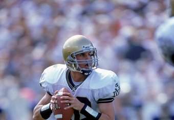 14 Oct 2000: Quarterback Matt LoVecchio #10 of the Notre Dame Fighting Irish scarmbles as he looks to pass the ball during the game against the Navy Midshipmen at the Citrus Bowl in Orlando, Florida. The Fighting Irish defeated the Midshipmen 41-14. Manda