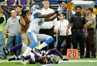 MINNEAPOLIS, MN - SEPTEMBER 25: Calvin Johnson #81 of the Detroit Lions makes a catch over Cedric Griffin #23 of the Minnesota Vikings in overtime on September 25, 2011 at Hubert H. Humphrey Metrodome in Minneapolis, Minnesota. The Lions defeated the Viki