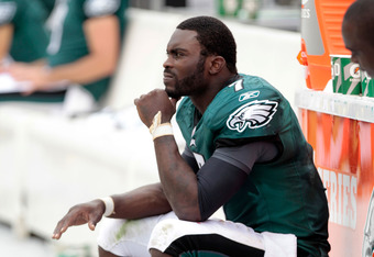 PHILADELPHIA, PA - SEPTEMBER 25:  Michael Vick #7 of the Philadelphia Eagles sits on the sideline with an injured right hand in the fourth quarter against the New York Giants at Lincoln Financial Field on September 25, 2011 in Philadelphia, Pennsylvania.