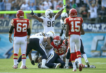 SAN DIEGO - SEPTEMBER 25:  Linebacker Antwan Barnes #98 of the San Diego Chargers  celebrates after Eric Weddle's  interception in the last minute of the game stopped the Kansas City Chiefs final drive at Qualcomm Stadium on September 25, 2011 in San Dieg