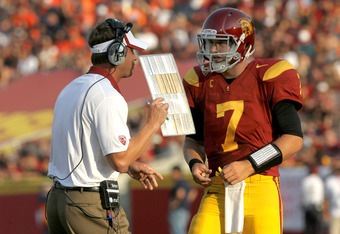 LOS ANGELES - SEPTEMBER 17:   Head coach Lane Kiffin and quarterback Matt Barkley #7 of the USC Trojans confer during the game with the Syracuse Orangemen at the Los Angeles Memorial Coliseum on September 17, 2011 in Los Angeles, California. USC won 38-17
