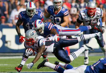 ORCHARD PARK, NY - SEPTEMBER 25:  Stevan Ridley #22 of the New England Patriots is tackled by George Wilson #37 of the Buffalo Bills at Ralph Wilson Stadium on September 25, 2011 in Orchard Park, New York. Buffalo won 34-31.  (Photo by Rick Stewart/Getty