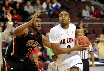 LAS VEGAS - NOVEMBER 26:  Kevin Parrom #3 of the Arizona Wildcats drives against Troy Payne #1 of the Santa Clara Broncos during the third round of the Las Vegas Invitational at The Orleans Arena November 26, 2010 in Las Vegas, Nevada. Arizona won 82-59.