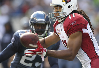 SEATTLE - SEPTEMBER 25:  Wide receiver Larry Fitzgerald #11 of the Arizona Cardinals makes a catch against Marcus Trufant #23 of the Seattle Seahawks at CenturyLink Field on September 25, 2011 in Seattle, Washington. The Seahawks defeated the Cardinals 13