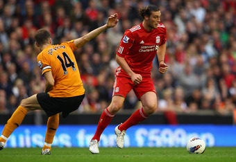 LIVERPOOL, ENGLAND - SEPTEMBER 24:  Andy Carroll (R) of Liverpool moves away from Roger Johnson of Wolverhampton Wanderers during the Barclays Premier League match between Liverpool and Wolverhampton Wanderers at Anfield on September 24, 2011 in Liverpool