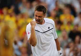LONDON, ENGLAND - JUNE 23:  Robin Soderling of Sweden celebrates victory during his second round match against Lleyton Hewitt of Australia on Day Four of the Wimbledon Lawn Tennis Championships at the All England Lawn Tennis and Croquet Club on June 23, 2