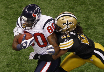 NEW ORLEANS, LA - SEPTEMBER 25:   Andre Johnson #80 of the Houston Texans is tackled by  Patrick Robinson #21 of the New Orleans Saints  at Louisiana Superdome on September 25, 2011 in New Orleans, Louisiana.  (Photo by Chris Graythen/Getty Images)