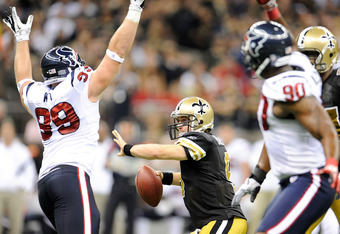 NEW ORLEANS, LA - SEPTEMBER 25:  Drew Brees #9 of the New Orleans Saints is pressured by J.J. Watt #99  of the Houston Texans during a game being held at the Louisiana Superdome on September 25, 2011 in New Orleans, Louisiana.  (Photo by Stacy Revere/Gett