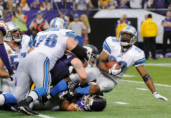 MINNEAPOLIS, MN - SEPTEMBER 25: Maurice Morris #28 of the Detroit Lions is tackled in the fourth quarter against the Minnesota Vikings on September 25, 2011 at Hubert H. Humphrey Metrodome in Minneapolis, Minnesota. The Lions defeated the Vikings 26-23. (