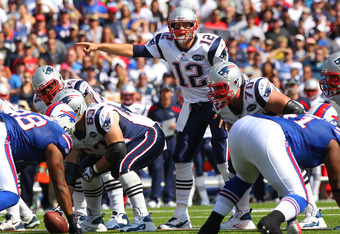ORCHARD PARK, NY - SEPTEMBER 25: Tom Brady #12 of the New England Patriots calls an audible during NFL game action against the Buffalo Bills at Ralph Wilson Stadium on September 25, 2011 in Orchard Park, New York. (Photo by Tom Szczerbowski/Getty Images)