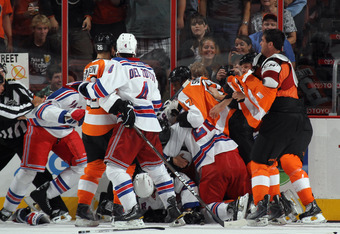 PHILADELPHIA, PA - SEPTEMBER 26: The New York Rangers and the Philadelphia Flyers mix it up in the first period following a hit by Tom Sestito of the Flyers during an NHL preseason game at Wells Fargo Center on September 26, 2011 in Philadelphia, Pennsylv