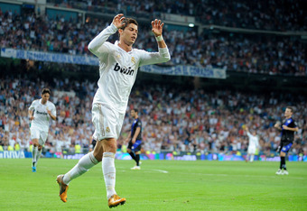 MADRID, SPAIN - SEPTEMBER 24: Cristiano Ronaldo of Real Madrid celebrates after scoring Real's opening goal during the La Liga match between Real Madrid and Rayo Vallecano at Estadio Santiago Bernabeu on September 24, 2011 in Madrid, Spain.  (Photo by Den