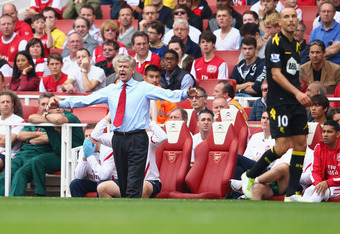 LONDON, ENGLAND - SEPTEMBER 24:  Arsene Wenger of Arsenal shouts during the Barclays Premier League match between Arsenal and Bolton Wanderers at Emirates Stadium on September 24, 2011 in London, England.  (Photo by Clive Mason/Getty Images)
