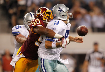 ARLINGTON, TX - SEPTEMBER 26:  Tony Romo #9 of the Dallas Cowboys is hit by Rob Jackson #50 of the Washington Redskins forcing a fumble that was recovered by Dallas during their game at Cowboys Stadium on September 26, 2011 in Arlington, Texas.  (Photo by