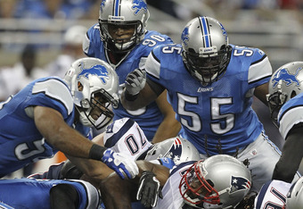 DETROIT - AUGUST 27:  Justin Durant #57 and Ndamukong Suh #90 of the Detroit Lions makes the stop on BenJavus Green-Ellis #42 of the New England Patriots during the first quarter of the game at Ford Field on August 27, 2011 in Detroit, Michigan.  (Photo b