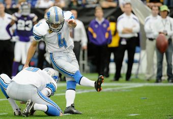 MINNEAPOLIS, MN - SEPTEMBER 25: Ryan Donahue #6 of the Detroit Lions holds the ball as Jason Hanson #4 of the Detroit Lions kicks a 32 yard field goal against the Minnesota Vikings overtime for the win on September 25, 2011 at Hubert H. Humphrey Metrodome