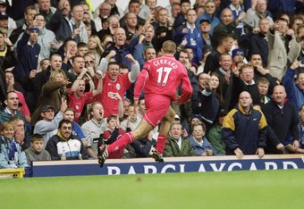 15 Sep 2001:  Steven Gerrard of Liverpool celebrates scoring his goal with fans during the FA Barclaycard Premiership match against Everton played at Goodison Park, in Liverpool, England. Liverpool won the match 3-1. \ Mandatory Credit: Shaun Botterill /A