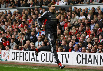 LIVERPOOL, ENGLAND - SEPTEMBER 24:  Steven Gerrard of Liverpool warms up on the touch line during the Barclays Premier League match between Liverpool and Wolverhampton Wanderers at Anfield on September 24, 2011 in Liverpool, England.  (Photo by Clive Brun