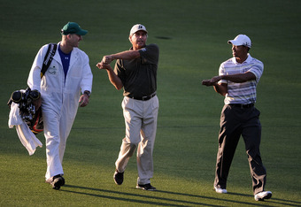 Tiger Woods with Fred Couples and Joe LaCava
