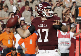 COLLEGE STATION, TX - SEPTEMBER 24:  Quarterback Ryan Tannehill #17 of the Texas A&M Aggies looks for a receiver as he throws against the Oklahoma State Cowboys at Kyle Field on September 24, 2011 in College Station, Texas.  (Photo by Bob Levey/Getty Imag