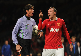 MANCHESTER, ENGLAND - SEPTEMBER 27:  Phil Jones of Manchester United protests to a match official after the UEFA Champions League Group C match between Manchester United and FC Basel at Old Trafford on September 27, 2011 in Manchester, England.  (Photo by