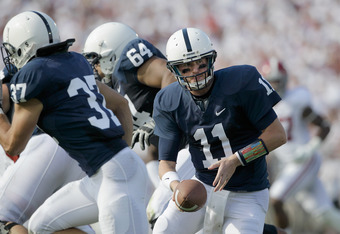 STATE COLLEGE, PA - SEPTEMBER 10:  Quarterback Matthew McGloin #11 of the Penn State Nittany Lions hands the ball off during the first half against the Alabama Crimson Tigers at Beaver Stadium on September 10, 2011 in State College, Pennsylvania.  (Photo